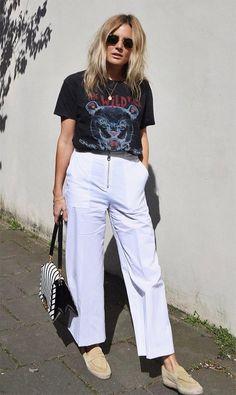 Lucy Williams usa calça social com t-shirt de banda