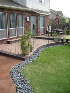 I like these decks that just flow into the yard without a railing - good if you are close enough to the ground for kids' safety (Rounded Patio Step) Backyard Patio Designs, Backyard Landscaping, Small Backyard Decks, Low Deck Designs, Landscaping Around Deck, Deck Patio, Small Backyards, Outside Living, Outdoor Living