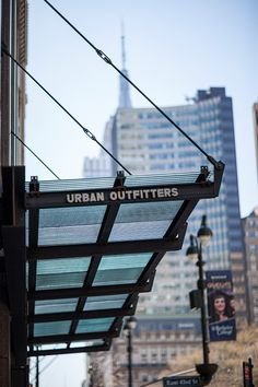 Canopy with BermanGlass Kiln Cast Glass in Corrugated texture with custom wire interlayer at Urban Outfitters - 521 Fifth Avenue, New York,… Canopy Glass, Metal Canopy, Sun Shades, Roof Detail, Cast Glass, Glass Roof, Retail Space, Wishful Thinking, Auckland