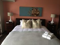 main bedroom Protea artwork @ rene Breedt Design by www.designsbyday.net