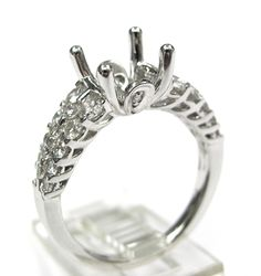 Ladies 14kt white gold semi mount. Mounted in ring are 22 brilliant round cut diamonds weighing a total of 1.1ct. Mounting is made to take approximately 1.5ct round diamond in the center.