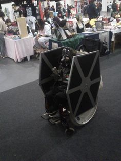 """""""The Force is strong with this one"""" - Fantastic Darth Vader Tie Fighter wheelchair costume."""