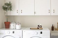 And transfer laundry cleaning products to pretty storage containers for a streamlined, minimalist-pleasing look.