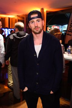 Chris Evans, you are the only person who can wear a grandpa sweater and a frat boy hat and make it work.