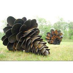 So cool. Re-purposed shovels: pinecones by Maine artist Patrick Plourdes.