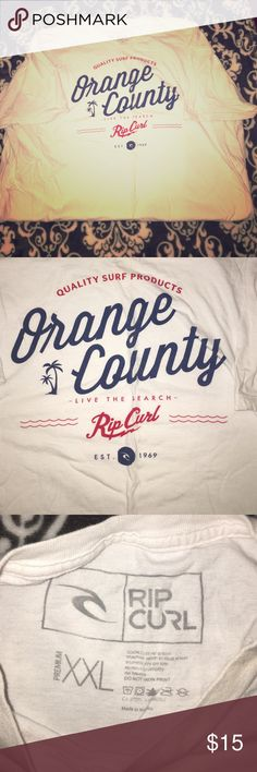 """**NWOT** Men's Rip Curl Tee Shirt XXL White Purchased and Never worn, the story of my boyfriend's closet. White Rip Curl shirt with Red and Blue Lettering. Perfect condition. XXL. Everything is our """"closet"""" is from our actual closets and it must go! We accept 95% of first offers, with no back and forth haggling, we just want these excess clothes gone. Check out our closet and make it a bundle. Rip Curl Shirts Tees - Short Sleeve"""