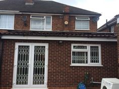 RSG1000 concertina security grilles fitted to a domestic property in Hounslow.