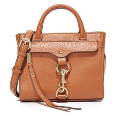 Dog clip tote cross body bag by Rebecca Minkoff. A pebbled leather Rebecca Minkoff cross body bag with a spring lock clasp over the zip front pocket. The snap top ope...