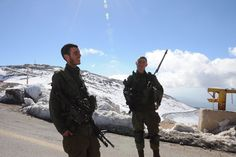 Two soldiers standing guard at the peak of Mount Hermon in the Israeli-occupied portion of the Golan Heights on Thursday, January 29, 2015. [Photo: CRIENGLISH.com / Zhang Jin]