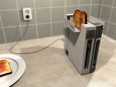 "f your NES Toaster, aka ""Nintendo Edibility System"" doesn't work, just blow on the bread. NES Toaster by =MyBurningEyes on deviantART Nes Console, Geek Out, Entertainment System, Nintendo Consoles, Old School, Geek Stuff, Entertaining, Cool Stuff, Random Stuff"