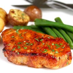 These Oven Baked Pork Chops are seasoned with simple spices and then baked to perfection. This baked pork chop recipe produces succulent, tender, juicy and flavorful pork chops every time! This baked pork chop recipe Oven Roasted Pork Chops, Best Baked Pork Chops, Cooking Boneless Pork Chops, Boneless Pork Loin Chops, Roasted Potatoes, Pork Loin Ribeye Chops Recipe, Pork Loin Centre Chops Recipe, Tender Pork Chops In Oven, Fingerling Potatoes