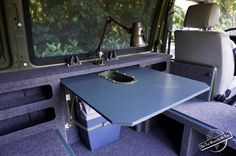 Removable Table and Salvaged Army Lamp of the Finished Campervan