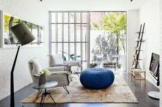 Gorgeous, yet simple room with blue pouf!  ||  COCOCOZY