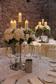 "The Tables were dressed with a combination of tall table designs firstly our glorious ""Baroque"" style candelabras overflowing with blousy blooms"
