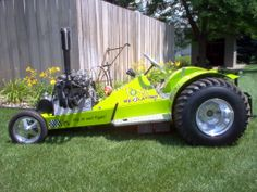 Super Modified Outlaw pulling tractor powered by a 126 H.P. Suzuki motorcycle engine.