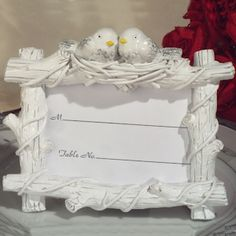 Lovebirds Place Card Holder (Cassiani Collection 1924)   Buy at Wedding Favors Unlimited (http://www.weddingfavorsunlimited.com/lovebirds_place_card_holder.html).
