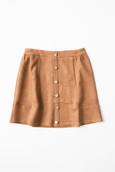 - Soft faux suede skirt - Button detailing in front - High waistline - Hidden back zipper - Material has a slight stretch - 95% Polyester 5% Spandex - Imported