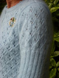 PDF version  A very feminine mohair cardi with ribbed sleeves, an all over eyelet pattern and a crocheted edging.     To fit bust 32 inch (8...
