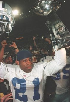 Deion Sanders with the Lombardi Trophy in hand after the Cowboys defeated the Steelers in Super Bowl XXX - Jan. Dallas Cowboys Baby, Cowboys 4, Dallas Cowboys Football, Football Team, Pittsburgh Steelers, Dallas Sports, Football Quotes, School Football, How Bout Them Cowboys