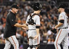 SAN DIEGO, CA - SEPTEMBER 19: Bruce Bochy #15 of the San Francisco Giants, left, comes to the mound to take Tim Hudson #17, right, out of the game as Buster Posey #28, center, looks on during the fifth inning of a baseball game against the San Diego Padres at Petco Park September, 19, 2014 in San Diego, California. (Photo by Denis Poroy/Getty Images)