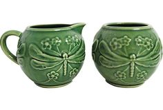"Green majolica sugar and creamer set. Marked ""Made in Portugal."" Dimensions: creamer, 4""L x 4""W; sugar, 5.5""L x 4""W x 4""H."