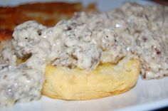 Biscuits with Sausage & Cream Cheese Gravy 1 can biscuits, 1 lb ground sausage, 2 tbs butter,1-8 ounce cream cheese cubed, 1/2-1cup milk, 1tbs black pepper, salt to taste. Bake biscuits, Brown sausage, drain, mix rest of ingredients