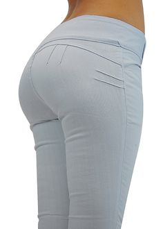 """White butt lift jeans featuring a button design on the front of the waistband with 2 button closure, front slit pockets and no pockets in the back. Made from 76% cotton, 22% polyester and 2% spandex. Rise is approx 7.5"""", inseam 31"""" and leg opening 5"""" (measured from size 7).  Price: $24.99"""