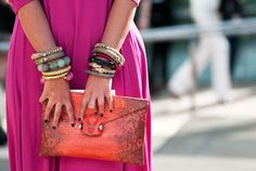 This eclectic mix of bracelets takes the party pink dress to a whole new (chicer, if you ask us) level.