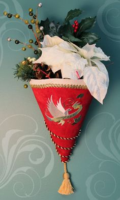 Free project instructions to make a cone-shaped Christmas wall hanging.