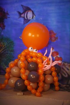 Air-filled balloon octopus used in photo backdrop.
