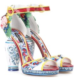 Dolce & Gabbana - Printed patent leather sandals - Put a pep in your step with Dolce & Gabbana's beautifully rendered leather sandals. Expertly crafted in the label's native Italy, this maiolica tile-inspired pair feature a vase-shaped heel that holds blooming flowers in a range of vibrant hues. Wear yours as the finishing touch to fit-and-flare dresses. seen @ www.mytheresa.com
