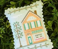 """Main Street Coffee Shop is the title of this cross stitch pattern from Country Cottage Needleworks"" #crossstitch #crafts"