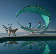 When I win the lotto and buy a mansion in the mountains with a pool I'm totally going to have this hammock...tee hee
