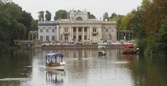 5 Free Things To Do In Warsaw, Poland (PHOTOS) | 5 Free Things In Warsaw | This Aug. 6, 2013 photo shows visitors taking a boat ride on a pond in front of the Palace on the Isle in the Lazienki Park in Warsaw, Poland. Part of the Royal Route, the 17th century Royal Baths park is one of the most picturesque parks in Europe. There is a charge for visitors to the ornate Palace on the Isle, but you can just stroll for free