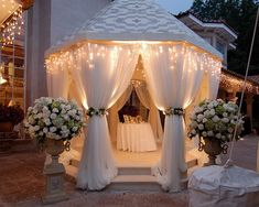 Beautiful lit gazebo with dripped icicles. Include flowers wrapped around each drape, as well as on each side of the gazebo itself in stone pots. If you have a passion for diamonds, decorate your pots with diamonds, ruby's, and other assorted jewels that you favor the most. Perfect entrance way when guests are entering into either cocktail hour or your reception.