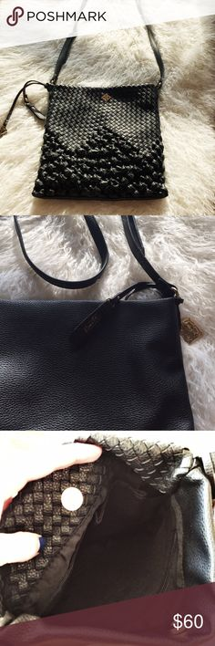"""{Nanette Lepore} Crossbody Purse Perfect condition. This stylish yet versatile crossbody bag was only carried for one weekend before realizing I did not need another medium black purse! Size 11"""" x 10"""". Strap is adjustable, with strap drop of 23"""" at the longest setting. Vegan leather. Lots of room with one large pocket on one side and two medium pockets on the other, of the lining. Magnetic snap closure. Super cute gold Nanette logo charm attached. Nanette Lepore Bags Crossbody Bags"""
