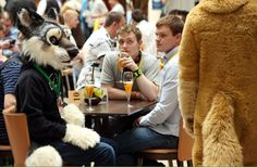 Berlin, Germany: Furry enthusiasts attend the Eurofurence. Furry fandom refers to a subculture whose followers express an interest in anthropomorphic - half-human, half-animal, creatures in artistic contexts. Berlin, Germany: furry enthusiasts attend the Eurofurence. Furry fandom is a subculture whose followers have an interest in anthropomorphic, or half-human, half-animal creatures in artistic contexts. Photograph: Adam Berry/Getty Images