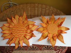 My 'Mod-rock' Sunflowers. These were made from layers of paper wrapped with wet plaster caste bandages and then painted with poster paints, yet to varnished and have stems attached to them!