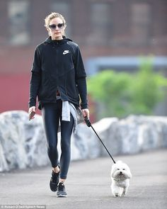 Gym fashionista:Olivia Palermo stripped it back on Saturday as she took her dog, Mr Butle...