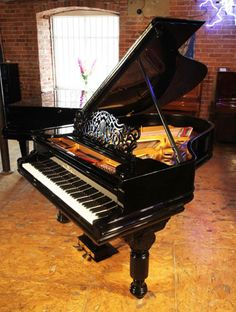 A rebuilt, 1887, Steinway Model A grand piano for sale with a black case, filigree music desk and fluted, barrel legs at Besbrode Pianos. Piano has an eighty-five note keyboard and a two-pedal lyre £27,000