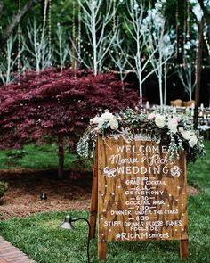 A Tennessee Wedding at the Couple's Log Cabin Home   Martha Stewart Weddings - After entering through the driveway, guests saw this hand-painted wooden sign lettered by Tenn Hens that served as the evening's itinerary. Memree and Rich opted for two cocktail hours, one before the ceremony and one immediately after.