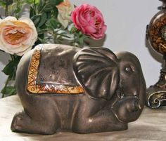 Thai Style Lucky Elephant Sitting with Trunk Curled