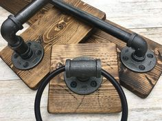 Industrial rustic bathroom set More Use the wood strips on the wall behind shelves of not over a stud?