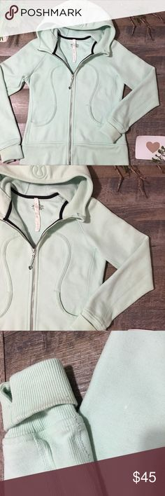 🎉SALE🛍 LuLuLemon Scuba Hooded Jacket Limited Edition Mint Green LuLuLemon Om Namaste Scuba Hooded Cotton Jacket. Emergency Hair Holder on Zipper. Thick & Warm. Thumbholes. Beautiful Hard to find Jacket!  Disclosure: TINY white stain on back sleeve. Never noticed until thoroughly looking before selling. Minimal pilling and a little wear on sleeve cuffs (Last 2 Pics). Lots of Life Left lululemon athletica Jackets & Coats