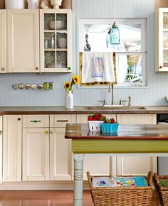 Adding country flare in an all-white kitchen can be easily attained by adding a bead-board backsplash! (via @Gayle Roberts Merry Homes and Gardens www.bhg.com)