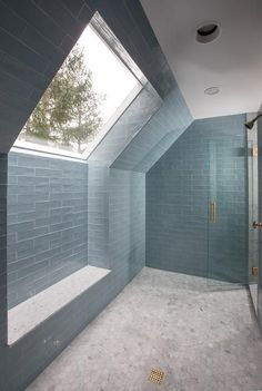 Stunning walk-in shower design with blue glass tiles and a built in bench | Gen Architects
