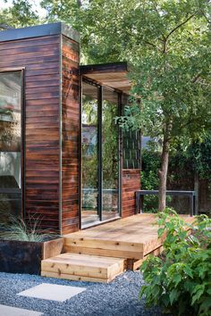 Charred wood siding in cherry stain
