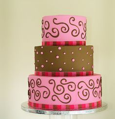 Pink and brown wedding cake decorated with ribbon, swirls and dots! Cake # 014.