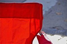 Red chair detail;  Chestnut Hill Street Fair; Philadelphia, Pennsylvania, USA.  October 2014.