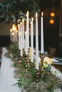 candle table runners - photo by Kate Ignatowski http://ruffledblog.com/new-orleans-inspired-wedding-ideas